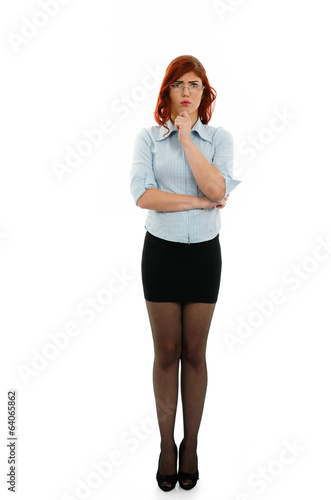 Full length portrait of a pensive business woman