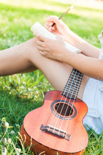 Song writer with little guitar