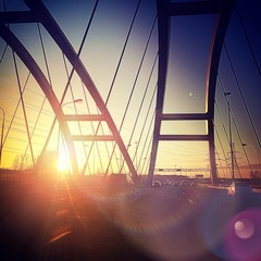 beautiful sunset on bridge in road