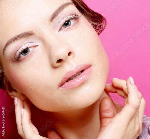 young woman over pink background