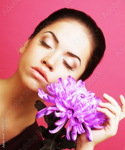beautiful woman with big purple flower