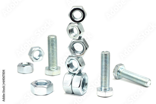 several anodized bolts and nuts on a white background