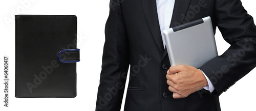 Business man holding tablet vs. organizer book isolated