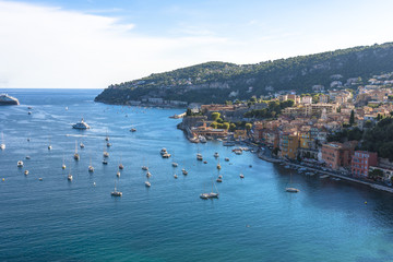 Aerial view of Villefranche-sur-Mer coast with yachts sailing in