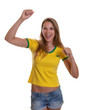 Cheering woman in a brazilian shirt