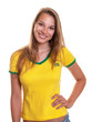 Laughing woman in brazilian shirt looking at camera