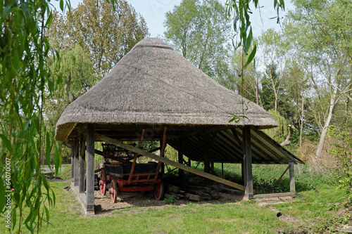 Old Thatched Barn with a  Hay Wagon