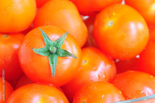 Close up view of small tomatoes called cherry .