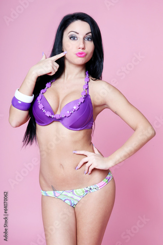 Sensual brunette with beachwear