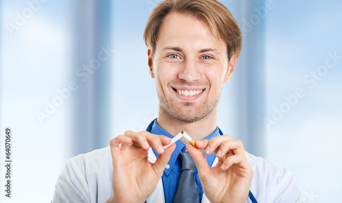 Young doctor breaking a cigarette