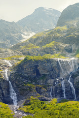 green mountains and waterfalls