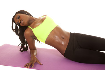 African American woman fitness green lay back