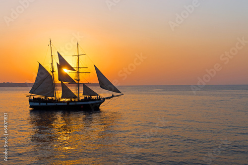 canvas print picture Romantic sunset with sailing ship