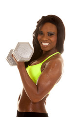 African American woman green bra weights curl side smile