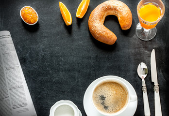 Continental breakfast on black chalkboard