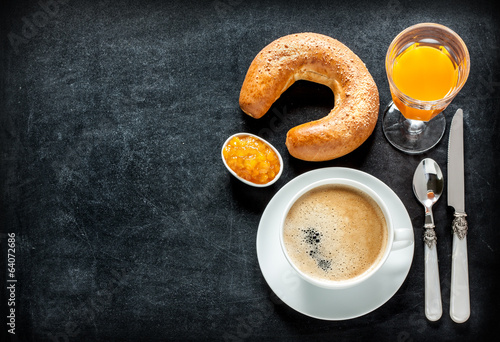 Continental breakfast on black chalkboard