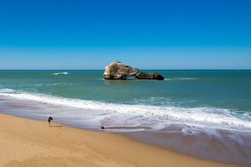 Biarritz beach, rocks and blue ocean, Aquitaine, France.
