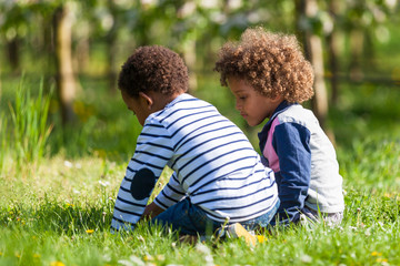 Cute african american little boys  playing outdoor - Black peopl