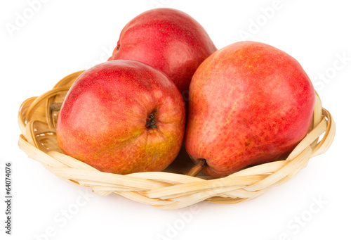 Three red pear in basket