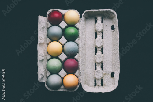 pastel colored easter eggs in a box