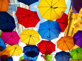 A lot of multicolored umbrellas over the sky