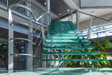 Glass stairway in a modern office building