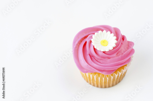 Pink cupcake with daisy decoration