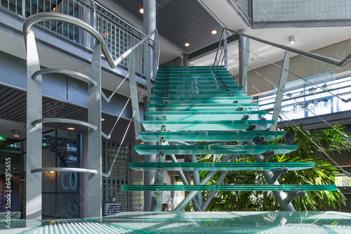 Glass stairway in a modern office building - 64075655