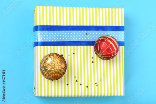 Colorful present with luxury ribbons  on color  background