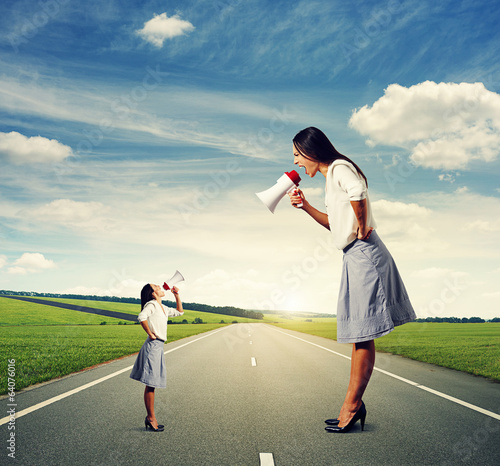 emotional two women with megaphone