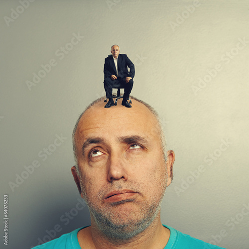 weary senior man with small businessman