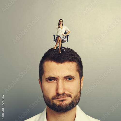 woman sitting on the displeased man