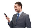 young smiling businessman with smartphone
