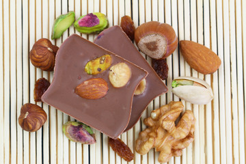 Milk chocolate with nuts, almonds and raisins