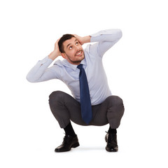smiling businessman crouching on the floor
