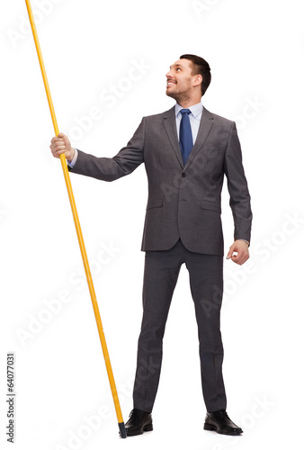 smiling man holding flagpole with imaginary flag