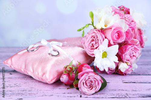 Beautiful wedding bouquet and cushion with rings