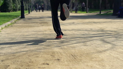 Joggers running in the park, super slow motion