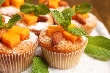 Tasty pumpkin muffins, close up