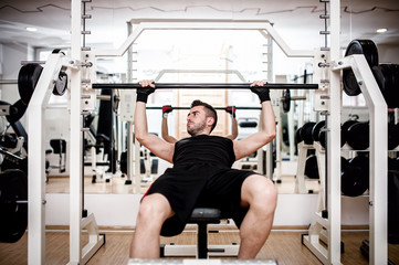 Man working out at gym, chest bench press exercise