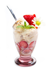 Vanilla ice cream with fresh strawberry in cup on white backgrou