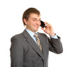 Smiling businessman talking by phone