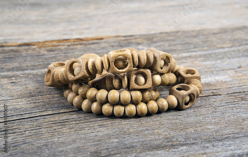 Wooden bracelets  on a wooden background