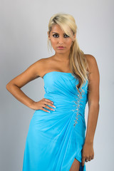 Pretty blonde woman with light blue sky dress..