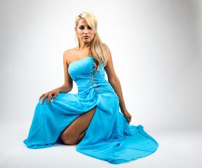 Pretty blonde woman with light blue sky dress..