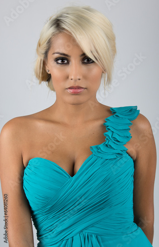 Pretty blonde woman with light blue or turquoise dress