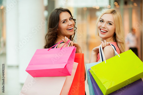 Happy friends shopping.