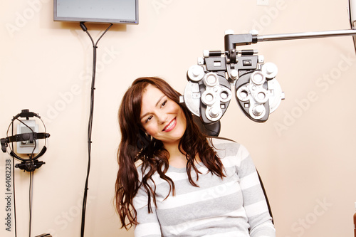 Young woman looking around optical equipment