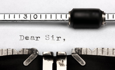 """Dear sir"" written on an old typewriter"