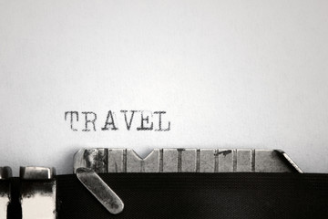 """Travel"" written on an old typewriter"